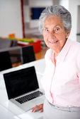Senior woman with a laptop — Stock Photo