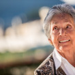 Stock Photo: Thoughtful elder woman