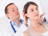 Woman at the doctor — Stock Photo