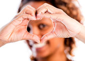 Woman making a heart — Stock Photo