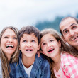 Stock Photo: Happy family outdoors
