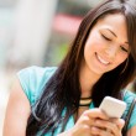 Woman sending a text message — Stock Photo