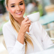 Woman drinking coffee — Stock Photo #25954833