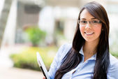 Business woman holding a laptop — Stock Photo