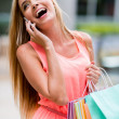 Stock Photo: Female shopper on the phone
