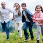 Family having fun outdoors — Stock Photo