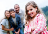 Happy girl with her family — Stock Photo