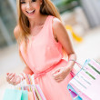 Woman on a shopping spree - Stock Photo