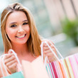 Happy female shopper — Stockfoto