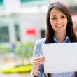 Business woman holding banner — Stock Photo