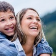 Happy mother and son — Stock Photo #26107385