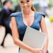 Business woman with a laptop — Stock Photo #26107413