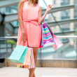 Happy female shopper - Stock Photo