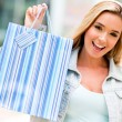 Stock Photo: Womholding shopping bag