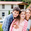 Family outside their house — Stock Photo