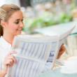 Stock Photo: Business womreading news
