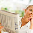 Business woman reading paper — Stock Photo