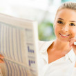 Stock Photo: Womreading newspaper