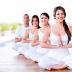 Group of doing yoga — Stock Photo