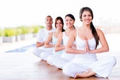 Group of doing yoga — Stock Photo