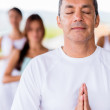 Man doing yoga — Stock Photo #26439365