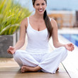 Woman doing yoga outdoors — Stock Photo