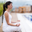 Wommeditating outdoors — Stock Photo #26480475