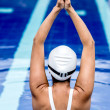Female swimmer stretching - Stockfoto