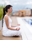 Woman meditating outdoors — Foto de Stock
