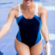 Woman coming out of the swimming pool — Stock Photo #26633679