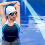 Female swimmer stretching — Stock Photo #26633689