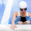 Woman in the swimming pool — Stock Photo #26633693