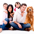Foto Stock: Happy family with dog