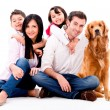 图库照片: Happy family with dog