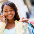 Stock Photo: Shopping womon phone