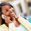Foto Stock: Female shopper on the phone