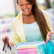 Surprised shopping woman — Stock Photo