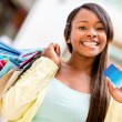 Female shopper with credit card — Stock Photo #26690473