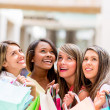Stock Photo: Shopping women looking up