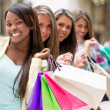 Stock Photo: Shopping women in row