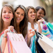 Happy group of shopping friends — Stock Photo