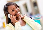 Female shopper on the phone — Stock Photo