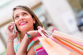 Female shopper on the phone — Stock Photo