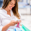 shopping woman texting — Stock Photo #26738557