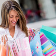 Shopping woman looking at purchases — Stock Photo