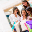 Foto Stock: Group of shopping girls