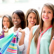 Happy girls shopping — Stock Photo