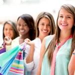 Happy girls shopping — Stock Photo