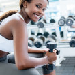 Gym woman exercising with weights — Stok Fotoğraf #26800411