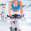 Gym woman doing spinning — Stock Photo #26800419